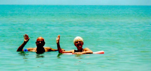 Barefoot beach swimming